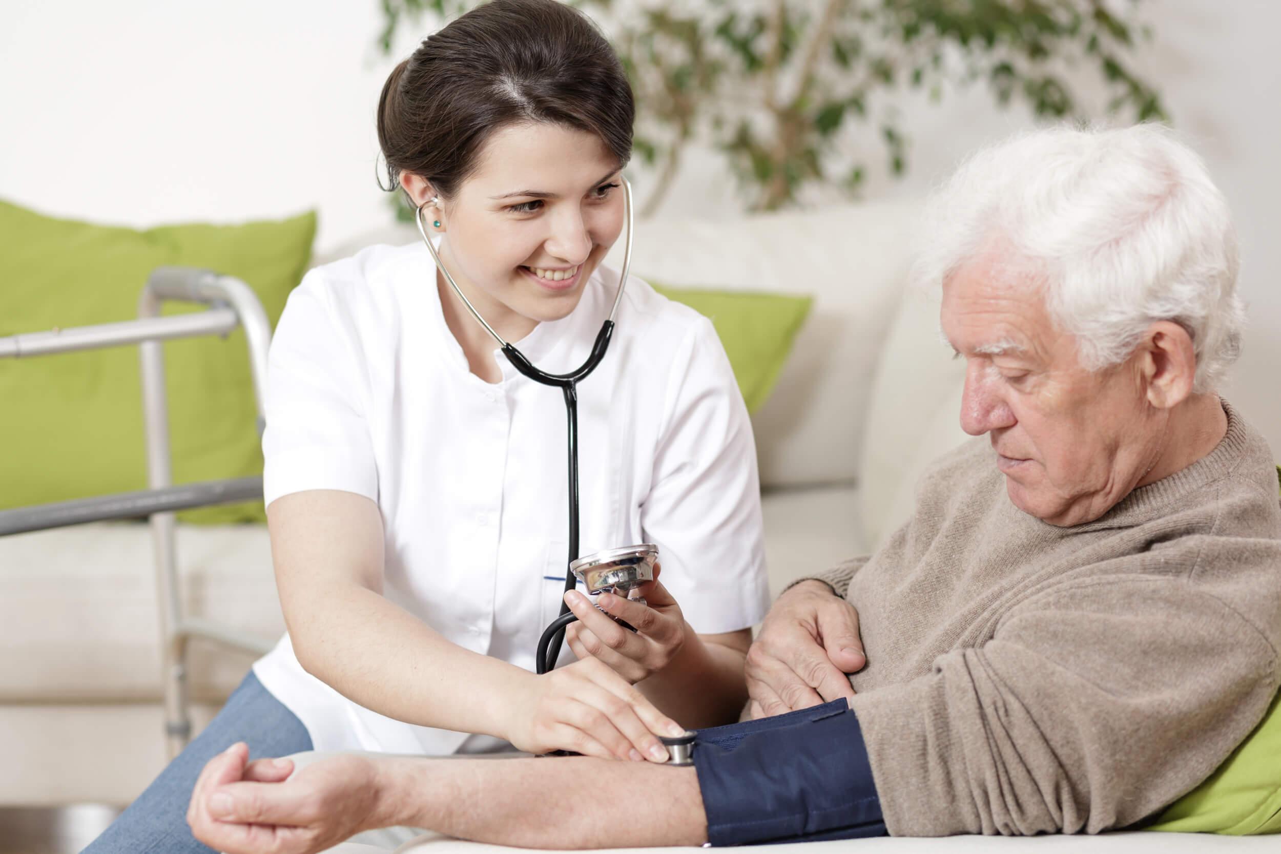 UK Caring Services Nurse Measuring Blood Pressure